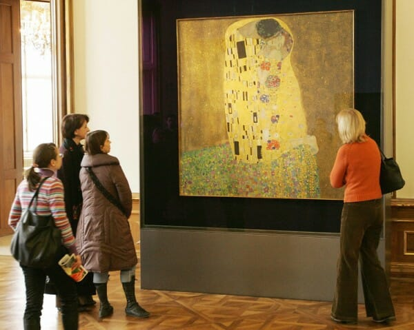 Visitors stand in front of Gustav Klimt´s painting 'Der Kuss' (The Kiss) at the Belvedere Museum in Vienna.